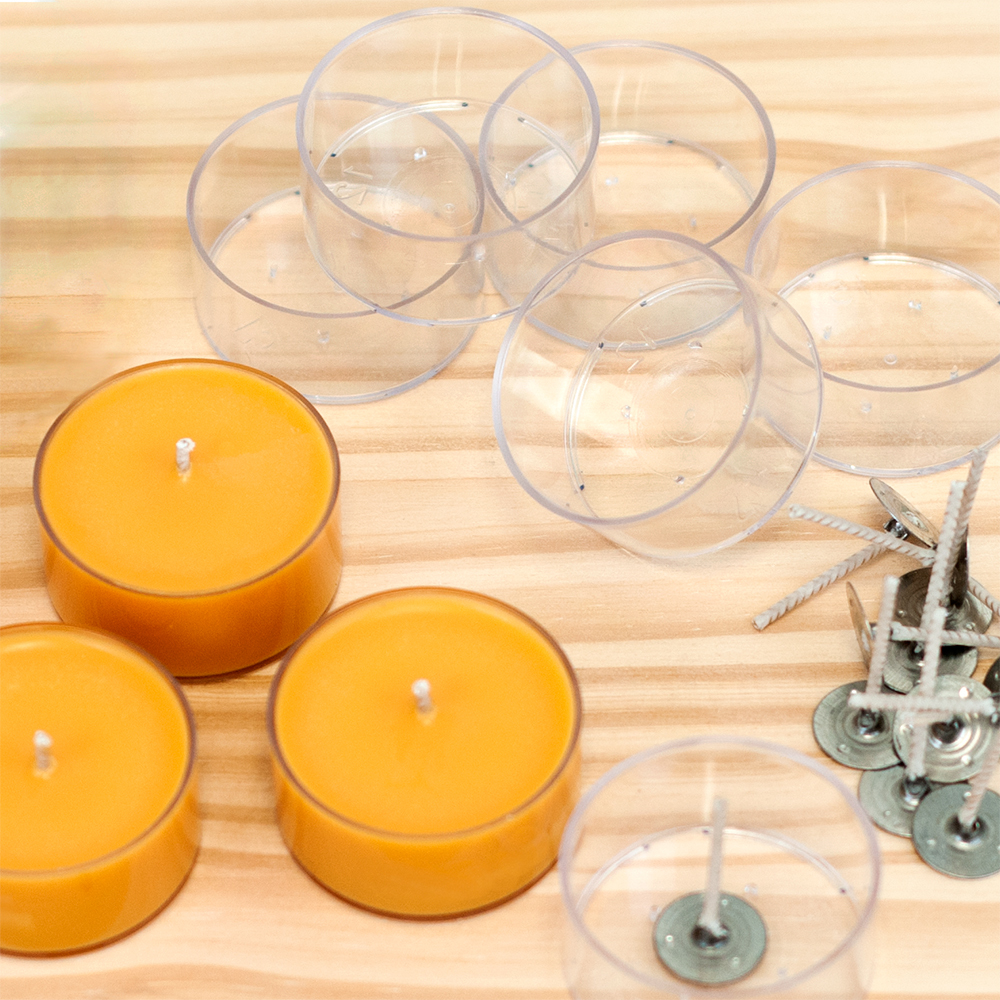 Making tealight candles on a wood table top