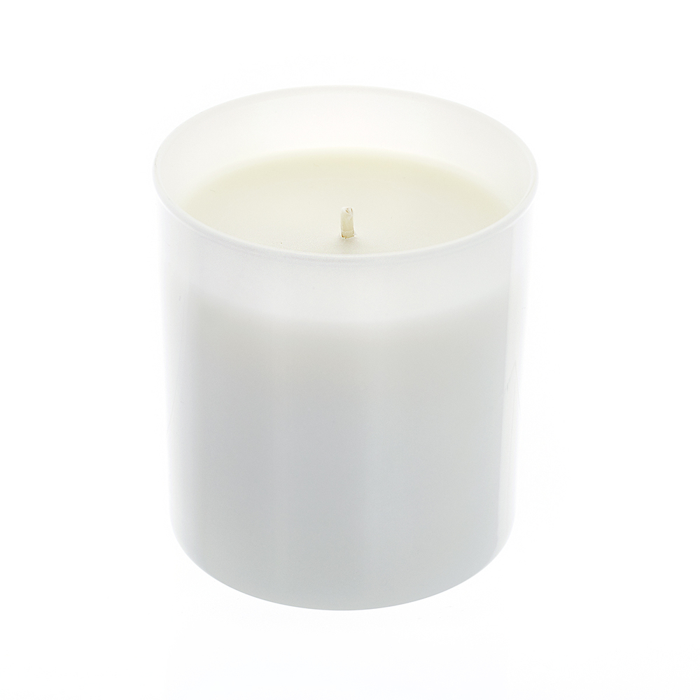 white tumbler jar with candle wax inside