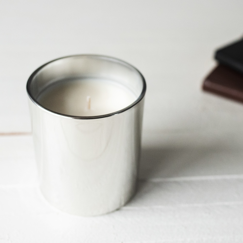 Silver Tumbler Jar candle on white counter top